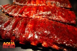 Three sets of glazed and smoked St. Louis Spare Ribs