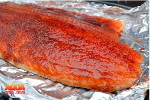 A piece of smoked Scottish salmon in aluminum foil