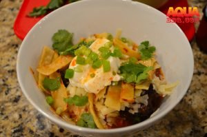 A small bowl with chili toppings