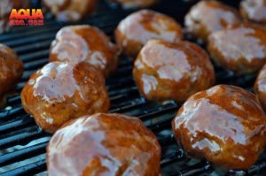 Glazed and smoked BBQ meatballs on the grill