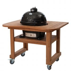 A wooden table holding a Primo Oval JR 200 grill