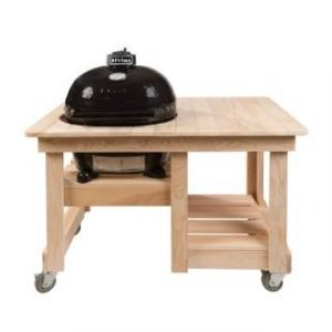 A primo grill in a wooden counter top table