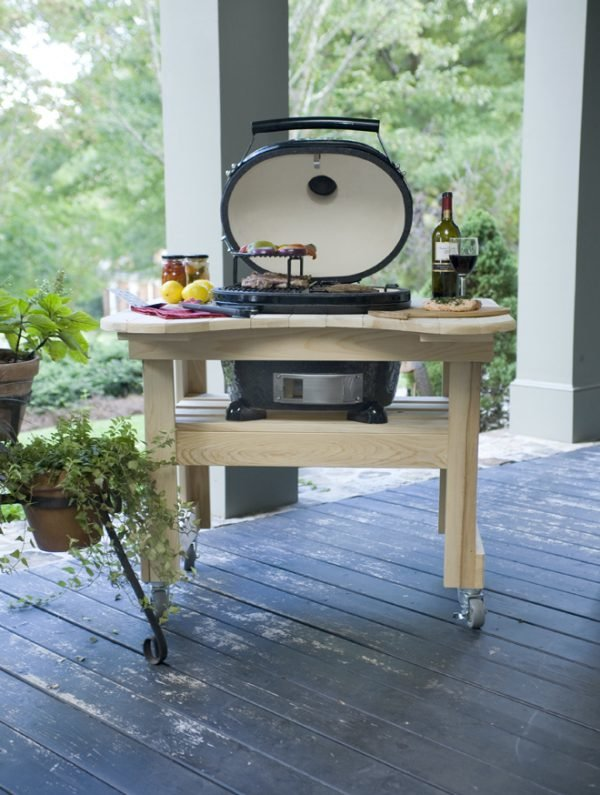 A cypress table with food and drink and an Oval Jr 200