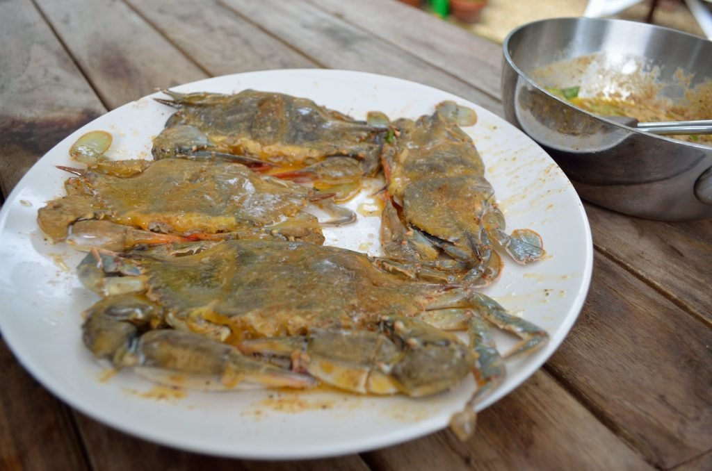 Prepare the Primo for direct grilling.  Prepare a butter sauce for basting- a tablespoon of butter per crab, an appropriate amount of Old Bay, and chopped scallions.  When ready to grill gently  pat dry the crabs and then top coat with the butter baste.