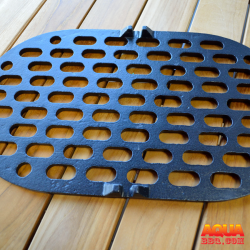 A cast iron charcoal grate on wood
