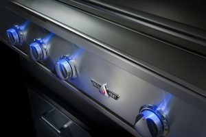 The Delta Heat grill with the knobs glowing in blue