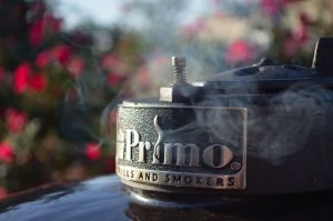 Smoke coming out of the top of a Primo Grill