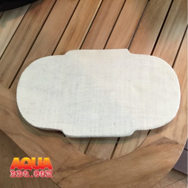A Ceramic Refractory plate on a wooden table