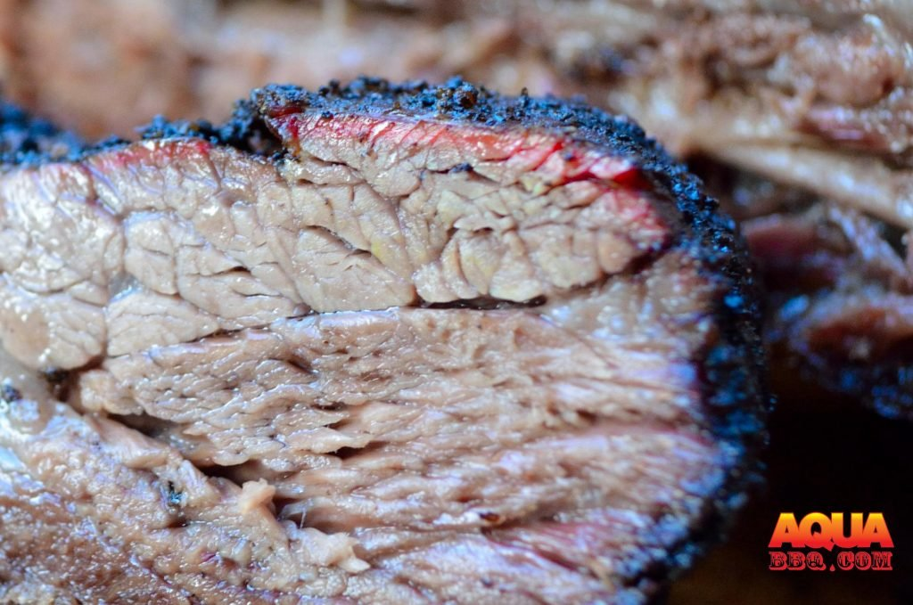 You will see a more prevalent smoke ring in areas with exposed meat vs fat cap.