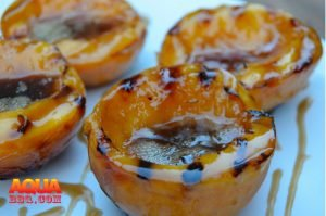 Grilled Peaches with a syrup on them